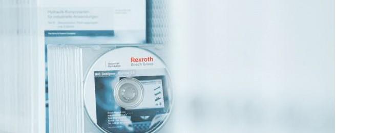 Stapel von Rexroth Dokumentations-CDs und Handbüchern für Verpackung und Verarbeitung
